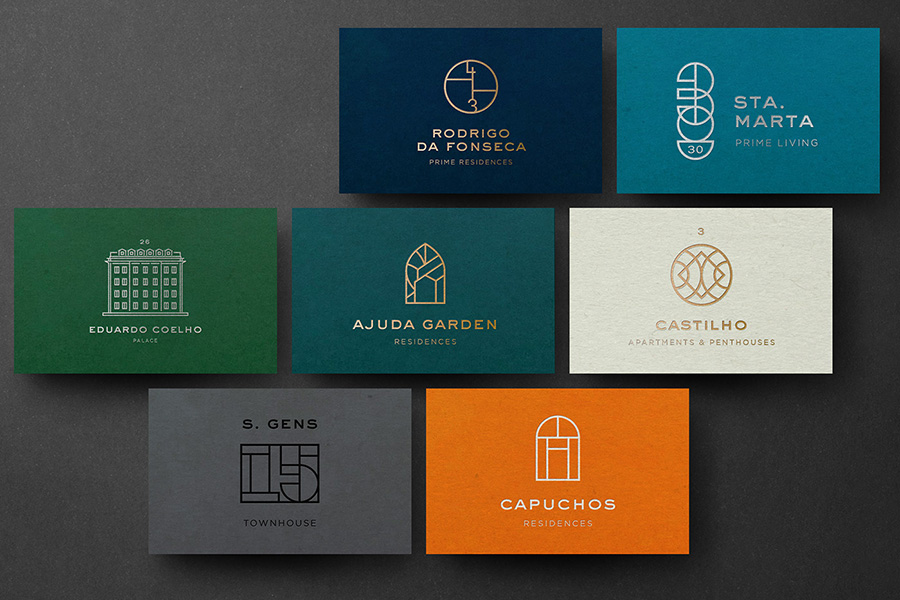 Collection of business cards for various investment properties under one brand