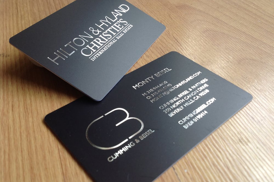 Satin black luxury business card with silver foil and rounded corners